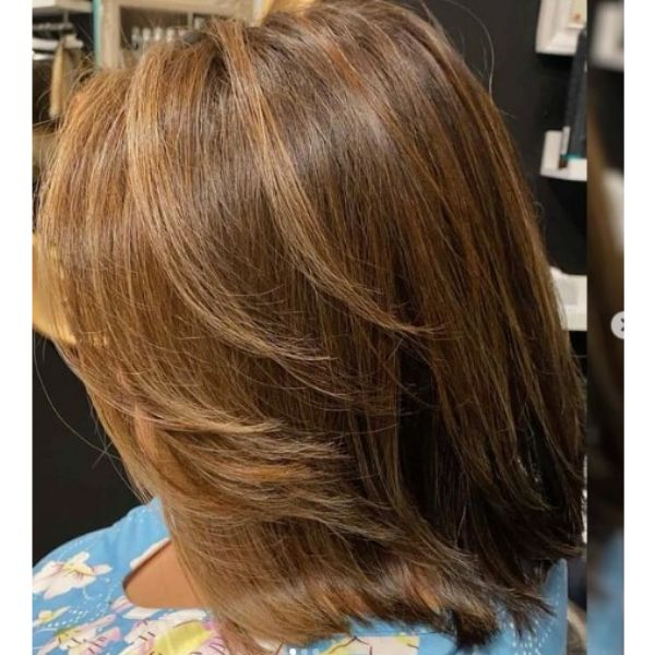 Medium Length Feathered Hairstyle With Long Bangs Hairstyle
