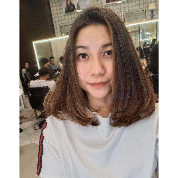 Medium Long Haircut For Oval Face With Soft Layers