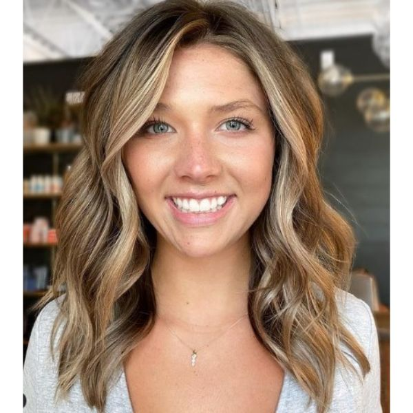 Medium Long Haircut With Front Blonde Highlights
