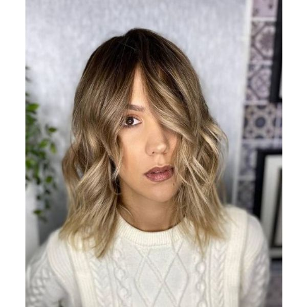 Medium Wavy Haircut With Subtle Baby Lights