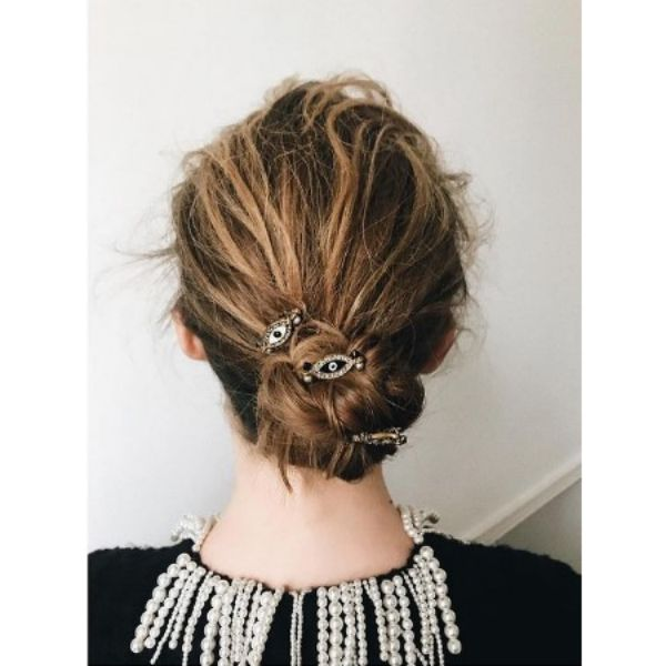 Messy Knotted Bun Hairstyle For Blonde Hair With Vintage Hair Pins