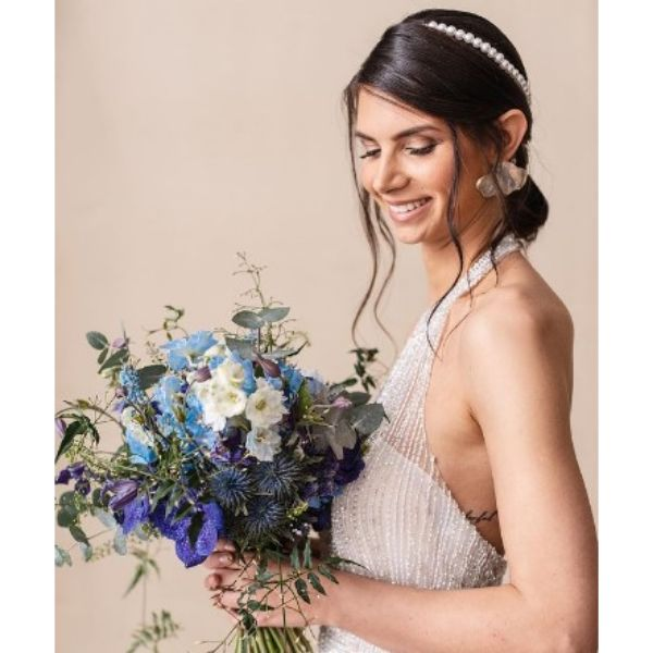 Messy Low Bun With Falling Strands Wedding Hairstyle For Medium Hair With Pearl Headband