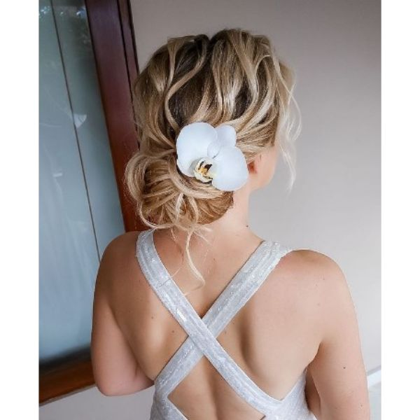 Messy Negligent Wedding Hairstyle With Floral Hair Pin