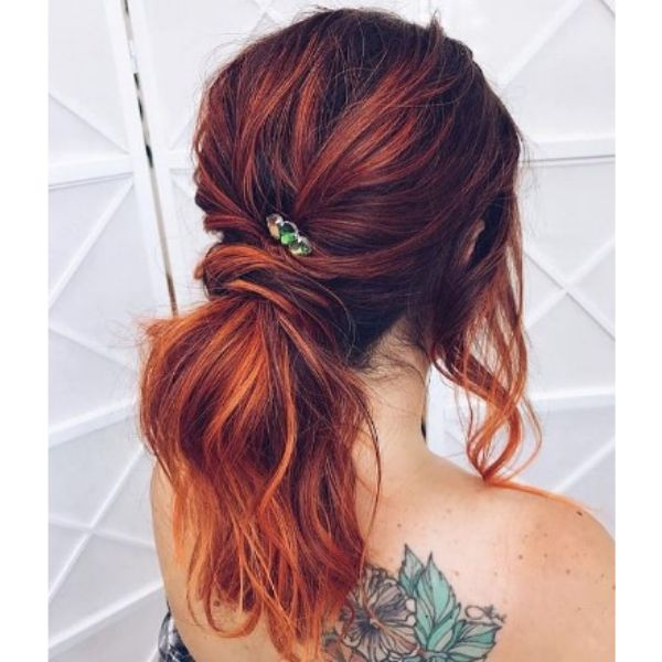 Messy Red Ponytail With Jewel Pin For Medium Hair