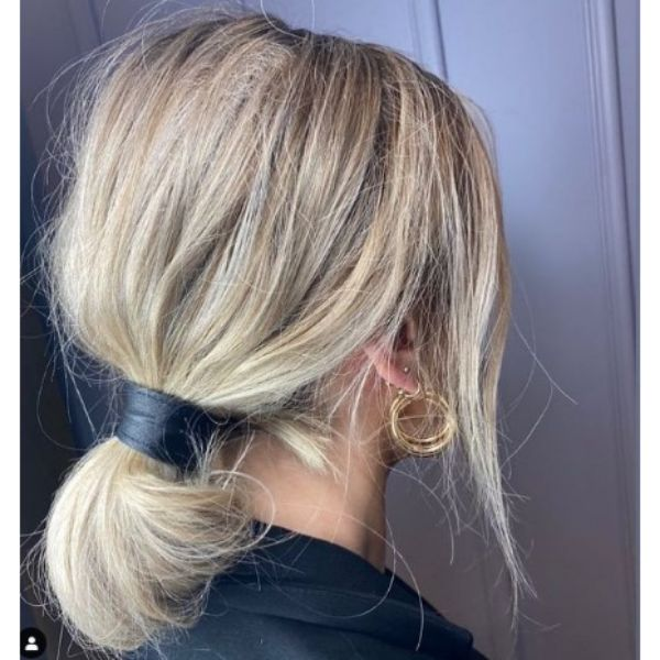 Messy Twisted Ponytail With Free Falling Strands For Blonde Thin Hair