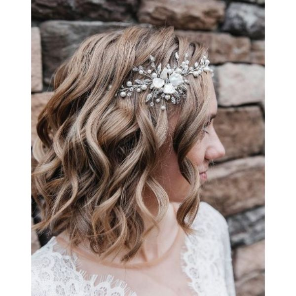 Messy Wedding Hairstyle For Medium Hair With Flower Accessory