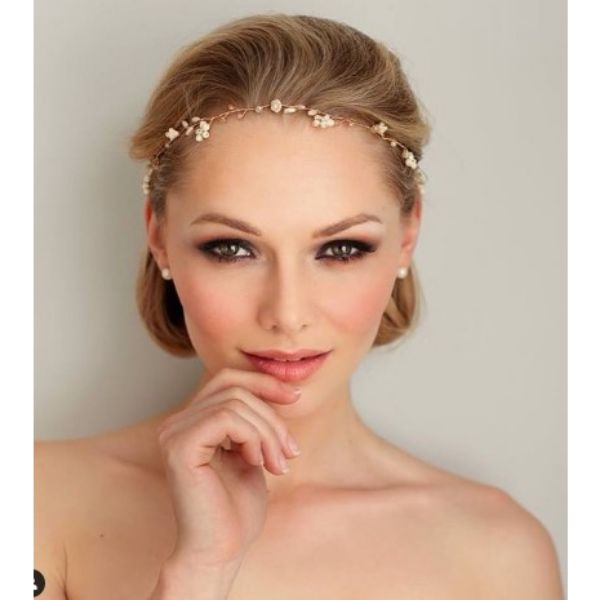 Modern Wedding Hairstyle With Thin Rose Gold Vine