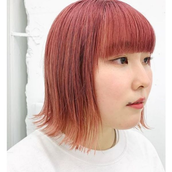 Red Colored Bob With Straight Bangs Hairstyle