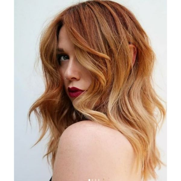 Red and Ginger Shades For Medium Wavy Shag With Long Bangs