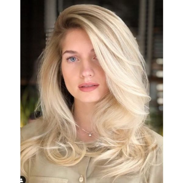 Romantic Waves Hairstyle With Deep Part