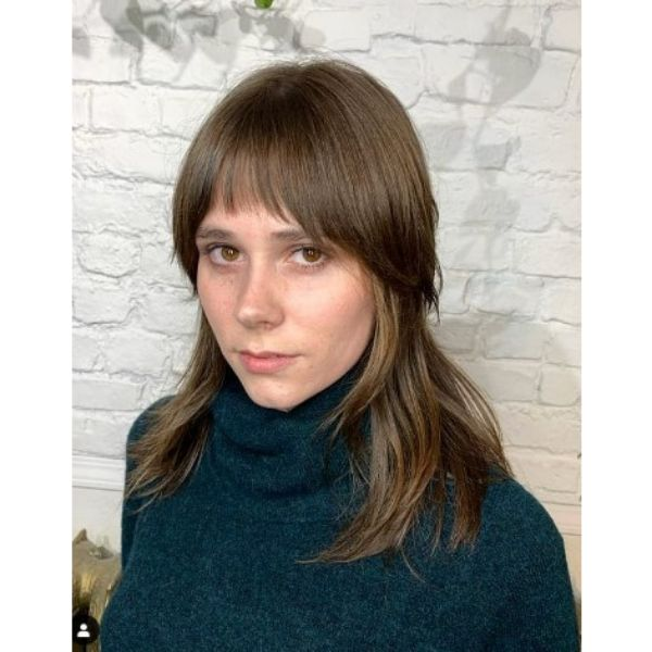 Shaggy Haircut With Straight Bangs For Brown Thin Hair