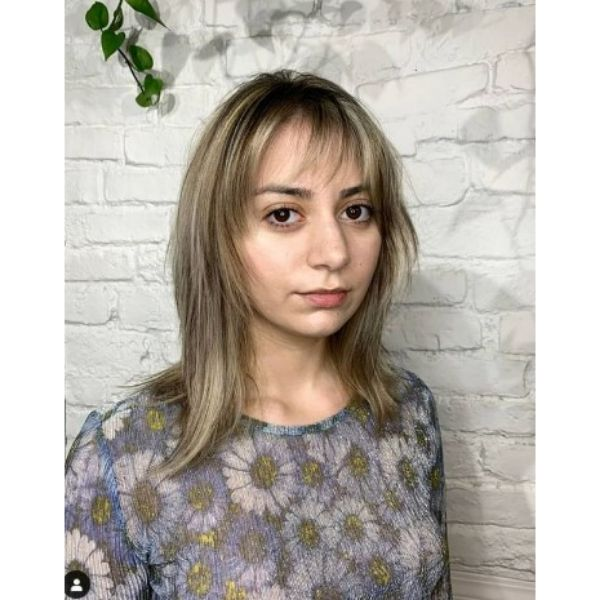 Shaggy Layered Cut With Straight Bangs For Thin Hair