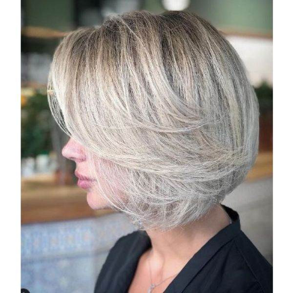 Short Bob With Subtle Feathered Layers For Silver Blonde Hair