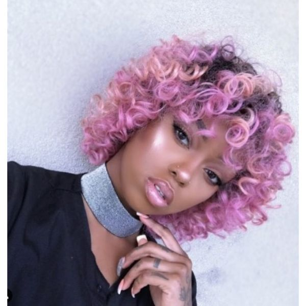 Short Curly Haircut With Lavender Pink Shades