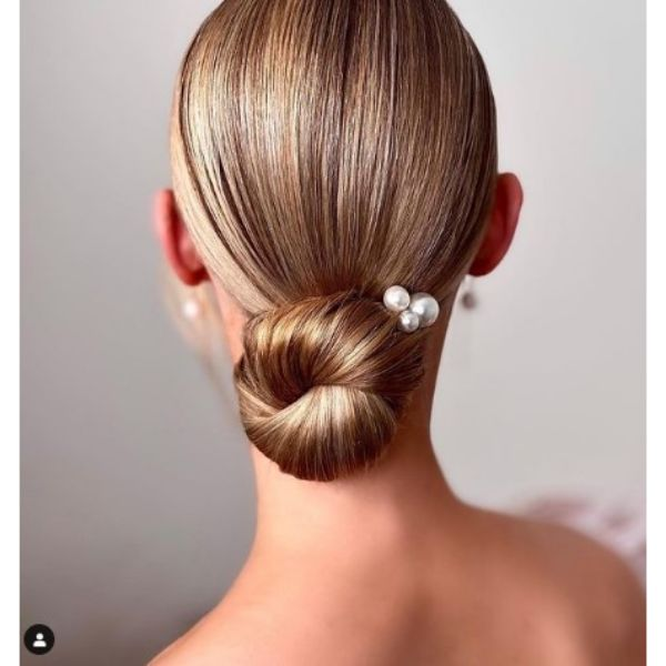 Sleek Knotted Low Bun With Pearl Pins