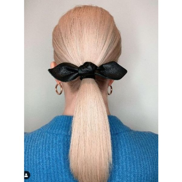 Sleek Straight Low Ponytail With Ribbon Hairstyle
