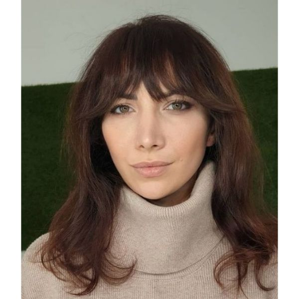 Soft Shag Haircut For Oval Face With Thick Bangs