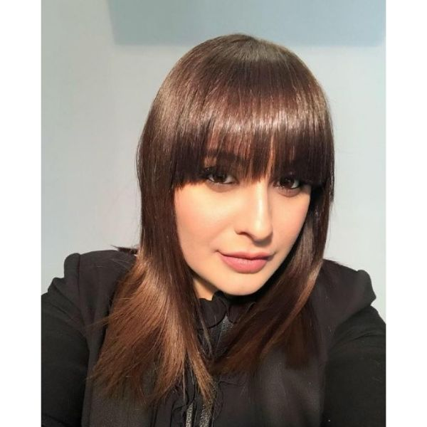 Soft Shiny Straight Haircut With Straight Bangs