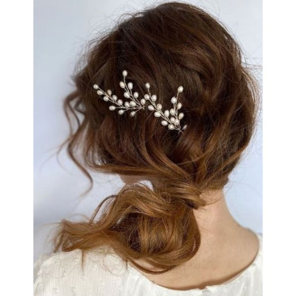 Soft Updo With Low Ponytail And Flower Pin