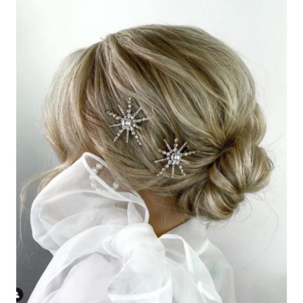 Textured Low Bun Hairstyle With Face Framing Pieces And Star Shaped Hairclips