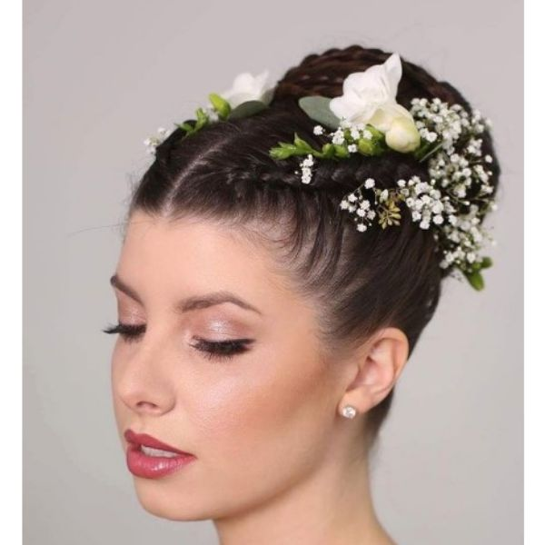 Tight French Braid Top Bun With White Flowers