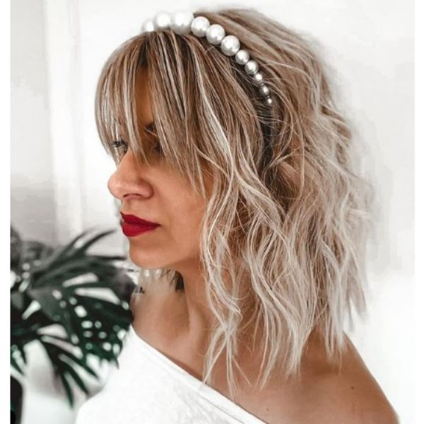 Undone Textured Wedding Hairstyle With Straight Bangs