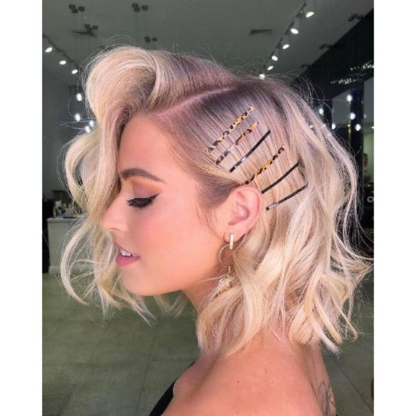 Voluminous Blonde Medium Haircut With Deep SIde Part And Hair Accessories