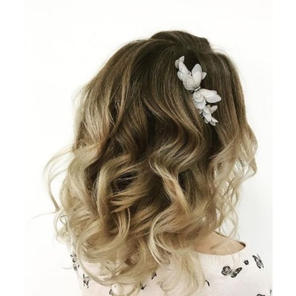 Wedding Hairstyles For Medium Wavy Hair With Flower Pin And Soft Waves
