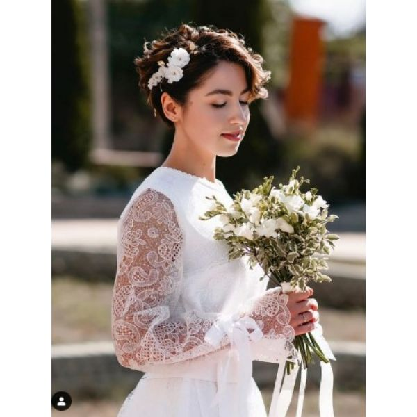 Curly Pixie With Side Flower Wedding Hairstyle