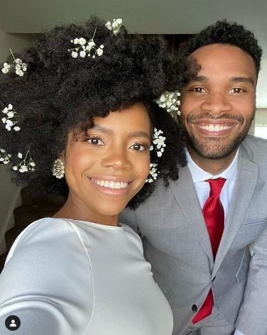 Short Afro Wedding Hairstyle With Flowers