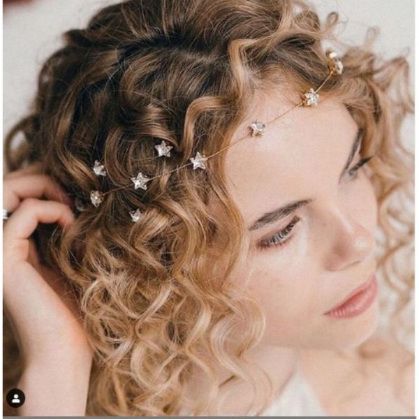 Short Curly Wedding Hairstyle With Whimsical Head Stars