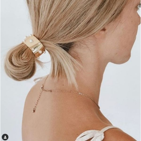 Short Twisted Pony Wedding Hairstyle Wth Pearl Encrusted Head Jewelry