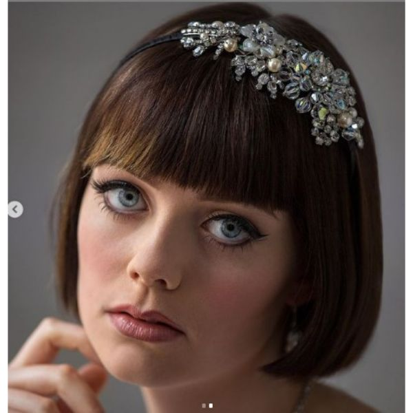 Vintage Inspired Wedding Hairstyle For Short Hair With Sleek Bon And Headpiece