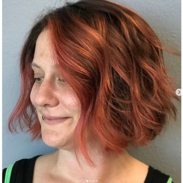 Coral Pink Curly Bob With Side Part