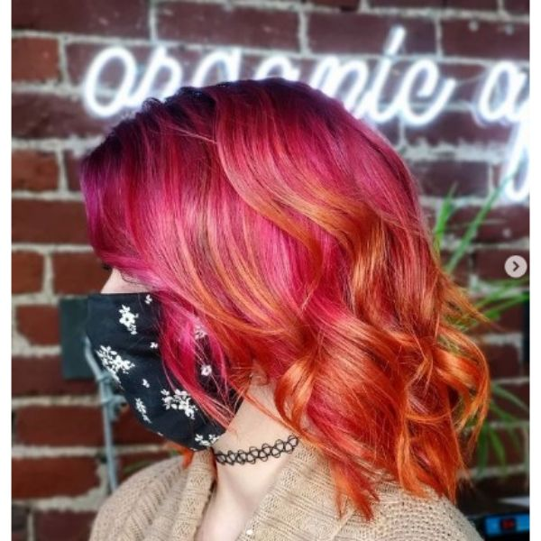 Coral Pink Long Curly Bob With Orange Highlights