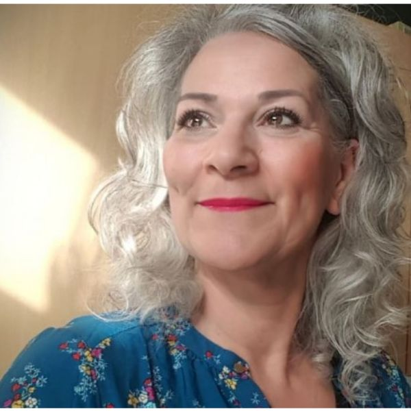 Curly Silver Grey Medium Long Hairstyle For Older Women