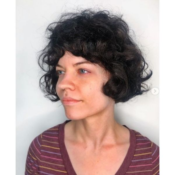French Curly Bob With Full Bangs Hairstyle