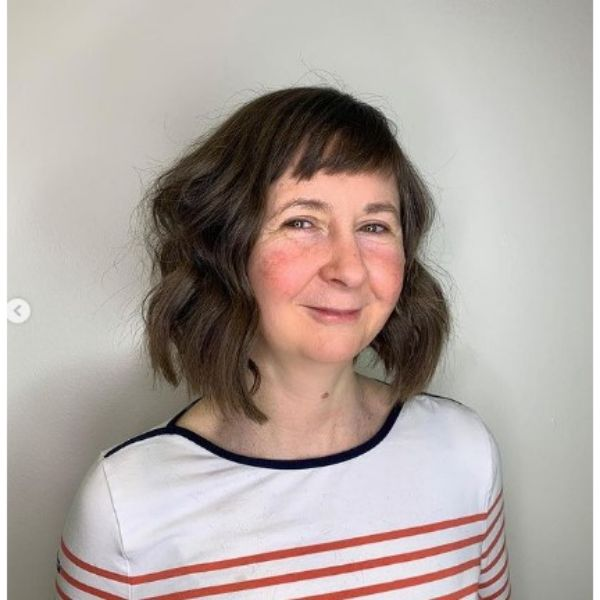 Funky Wavy Bob With Short Bangs Hairstyle For Older Women