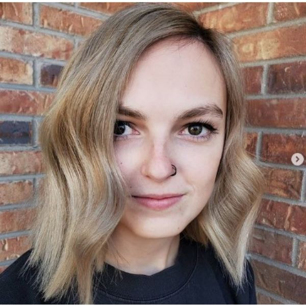 Gold Blonde Wavy Chopped Hairstyle