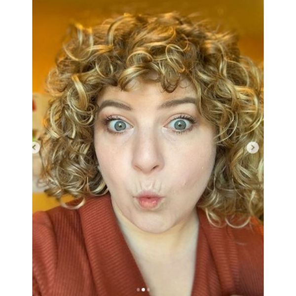 Golden Blonde Curly Bob With Straight Bangs Hair