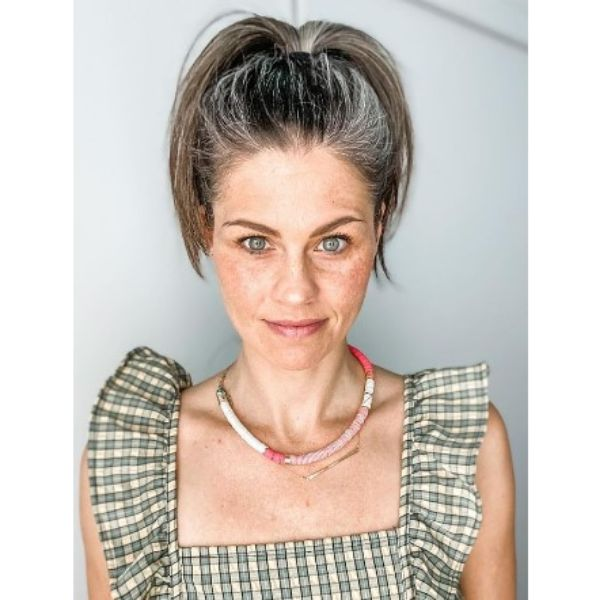 High Ponytail With Silver Gray Strands Hairstyle For Older Women
