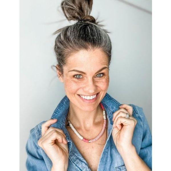 High Top Knot Medium Hairstyle With Silver Gray Strands