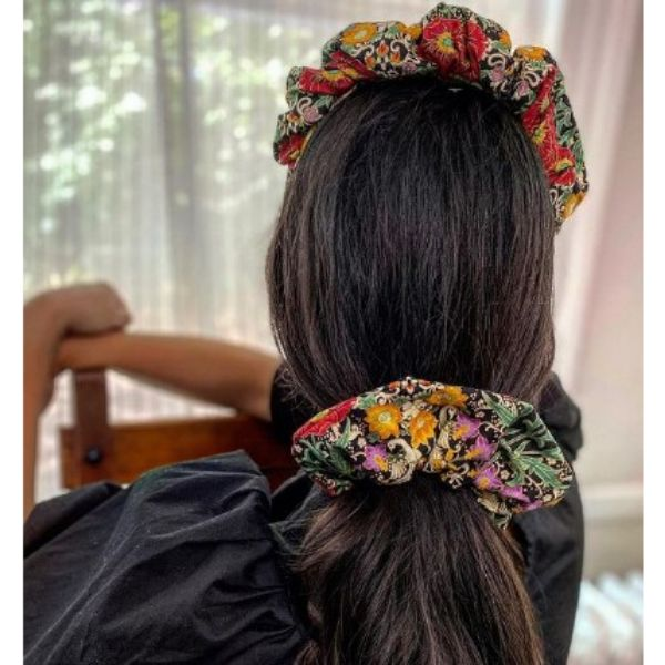 Low Loose Ponytail Hairstyles For Black Hair WIth Floral Scrunchies