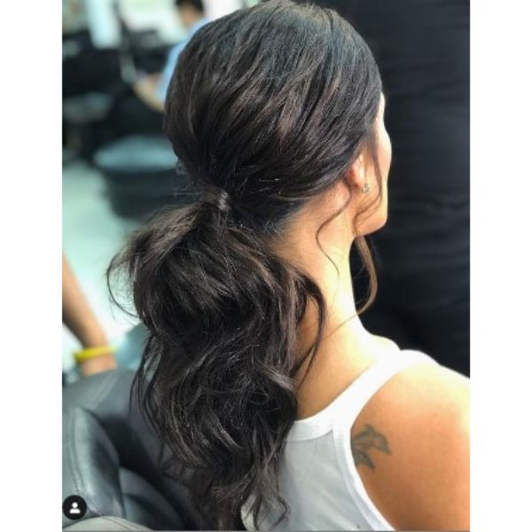 Low Ponytail With Wavy S-shape Hairstyles For Black Hair