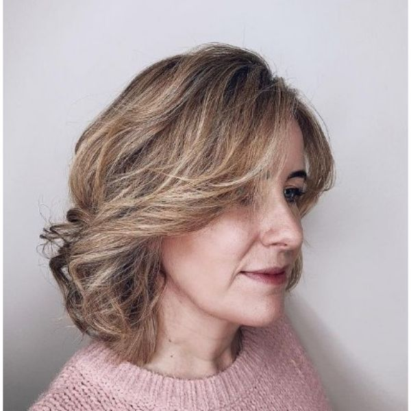 Medium Blonde Hairstyle With Feathered Layers