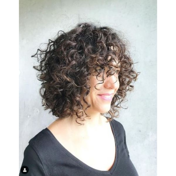 Medium Curly Bob Hairstyle With Curly Bangs For Older Women