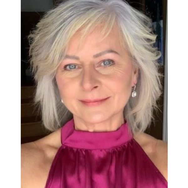 Medium Long White Feathered Hairstyle For Older Women