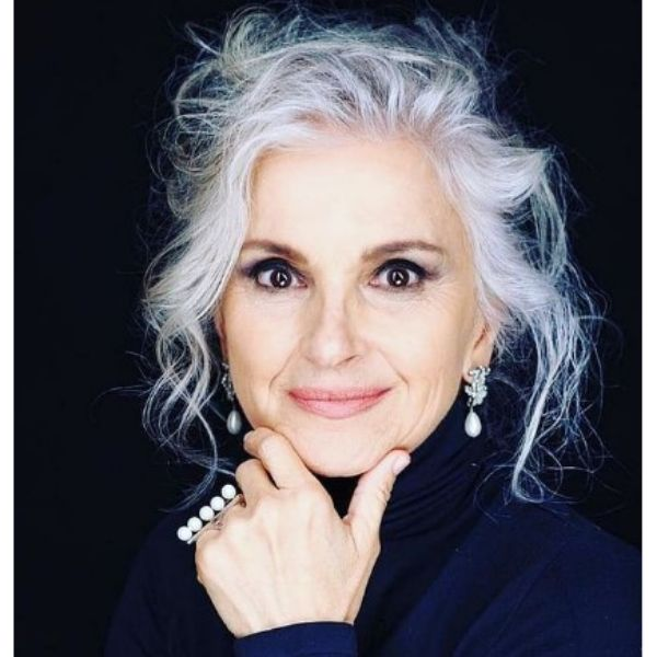 Messy Silver White Updo For Older Women With Falling Strands