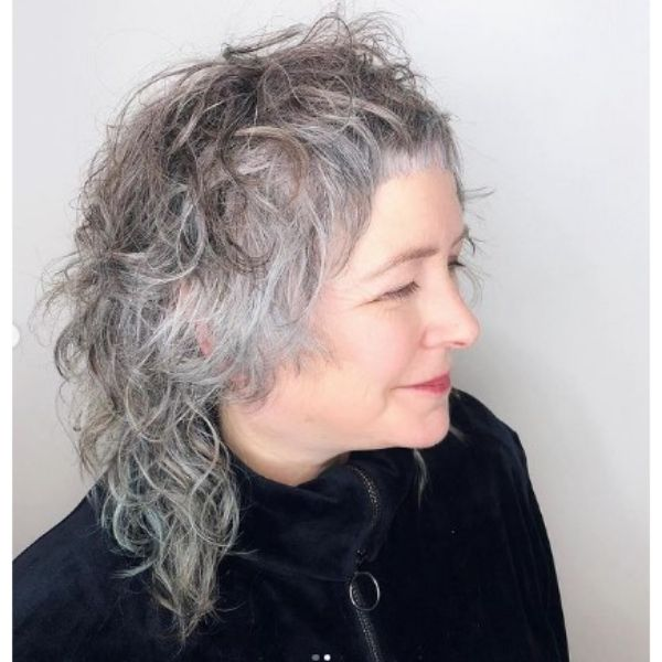 Modern Curly Shag With Baby Bangs Hairstyle For Older Women