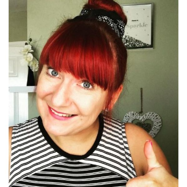 Scarfed Bun Medium Hairstyle With Red Straight Bangs Hairstyle For Older Women